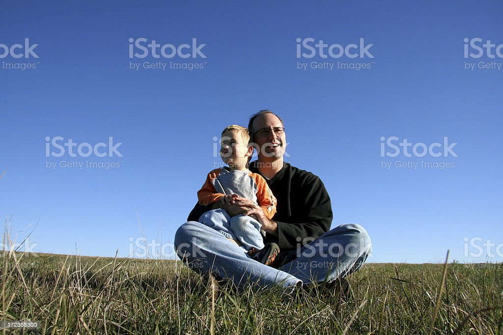 Dad and Son looking in different directions royalty-free stock photo