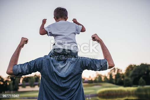 Dad and son having fun outdoors.