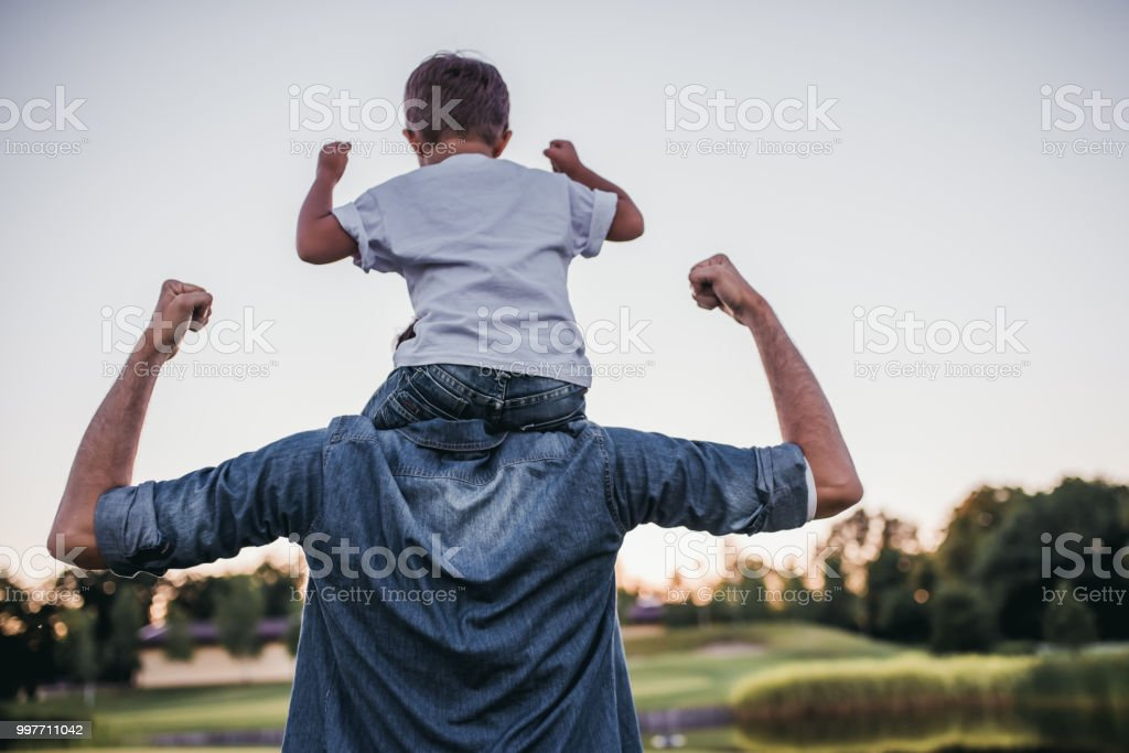 Dad and son outdoors stock photo