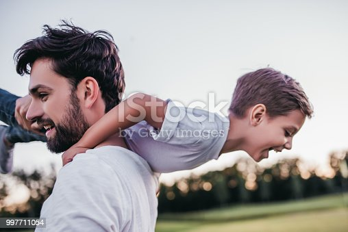 997711042istockphoto Dad and son outdoors 997711054