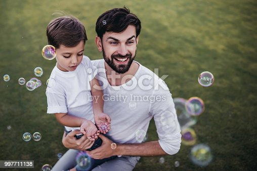 997711042istockphoto Dad and son outdoors 997711138