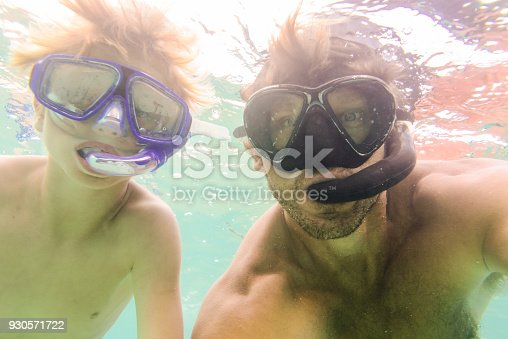 596350174istockphoto Dad and Son Snorkeling 930571722