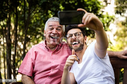 istock Dad and son taking selfie and having fun in the park 870798520
