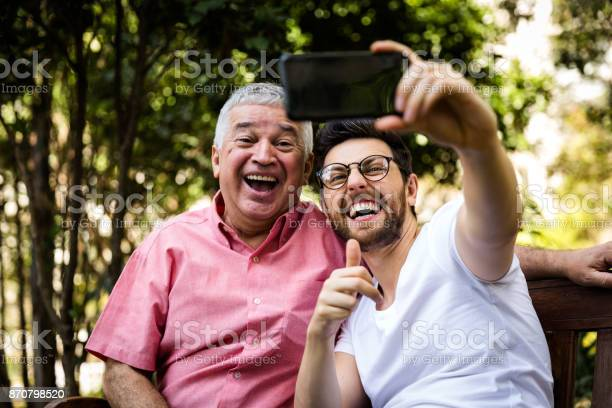 Dad and son taking selfie and having fun in the park picture id870798520?b=1&k=6&m=870798520&s=612x612&h=ut7pwudawbqp7yr0abrxr6m86ehfh2yohg8aujl0 pg=