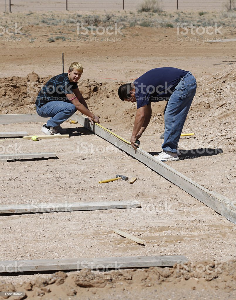 Dad and Teen Work on Construction Project royalty-free stock photo