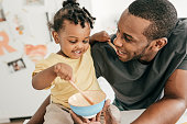 istock Dad and toddler eating snacks 1267547332