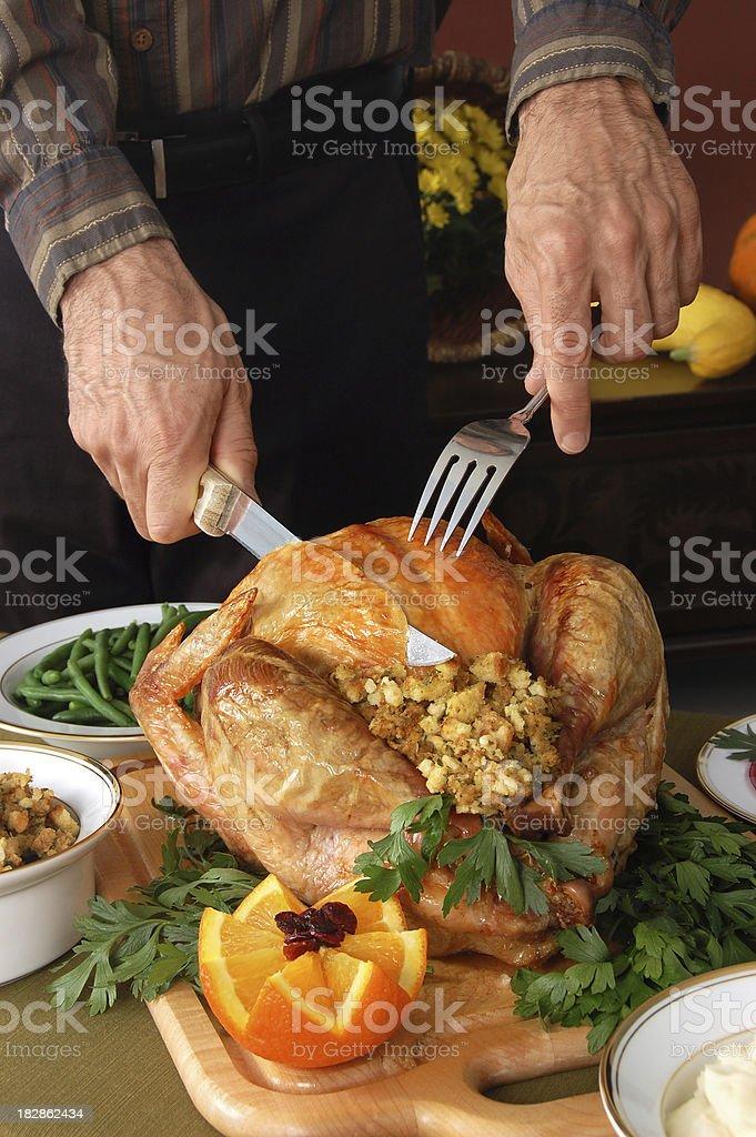 Dad Carves the Turkey stock photo