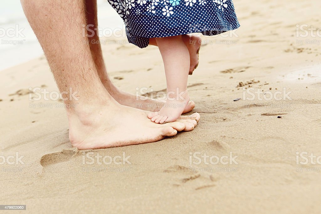 Dad Dancing on Beach with Baby Girl stock photo