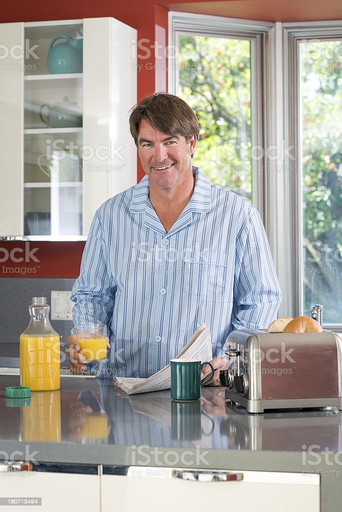 Dad Drinking Orange juice royalty-free stock photo
