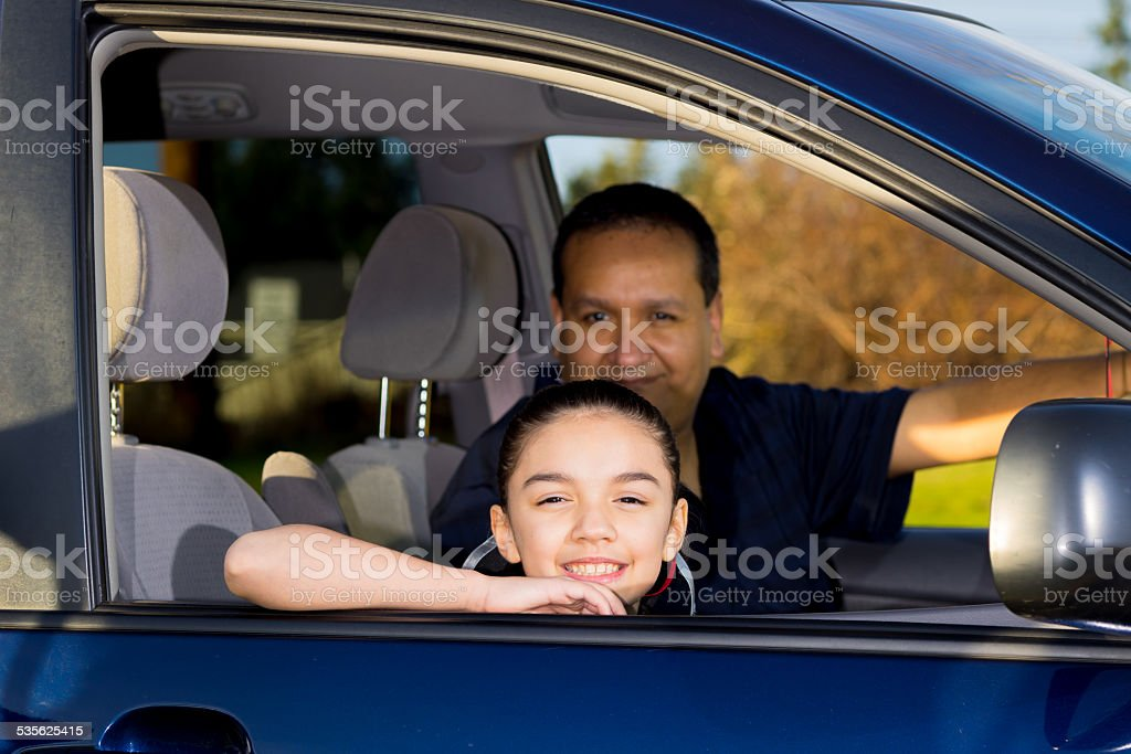 Dad Gets Ready To Drive Daughter To Practice stock photo