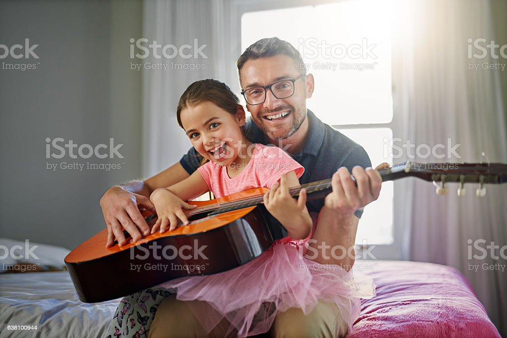 Dad Gives The Best Guitar Lessons Stock Photo & More Pictures of Adult