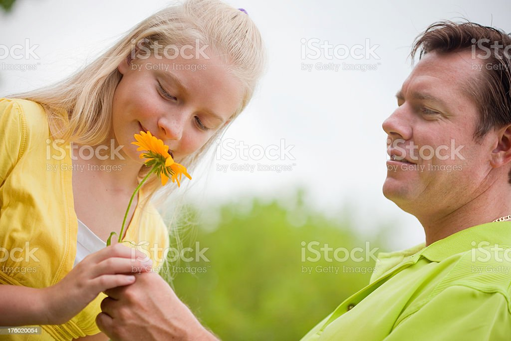 Dad giving his daughter a flower royalty-free stock photo