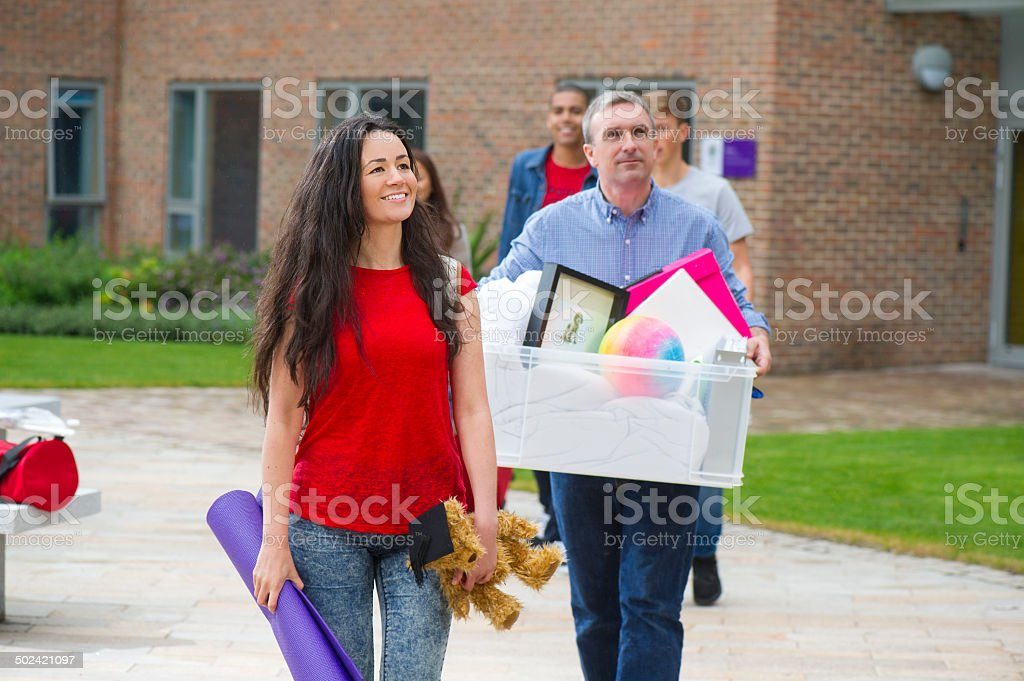 Dad helping daughter move into University stock photo
