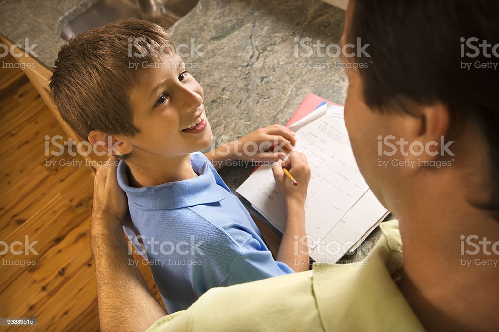 Dad helping son with homework. royalty-free stock photo