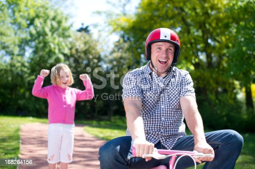 istock Dad learns to ride a bike 168264156