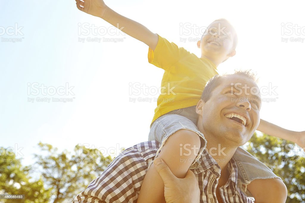 Dad makes me feel like I can fly royalty-free stock photo