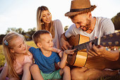 istock Dad, play us a song! 1016137200
