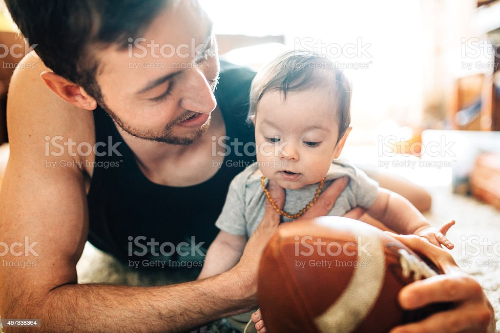 Dad Playing with Infant Son stock photo