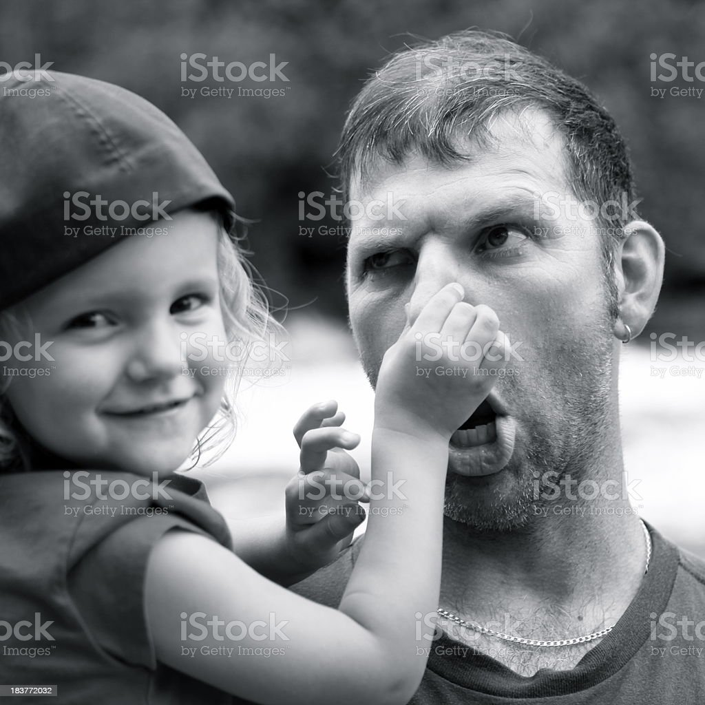 Dad Playing with Little Girl, Making Funny Face stock photo