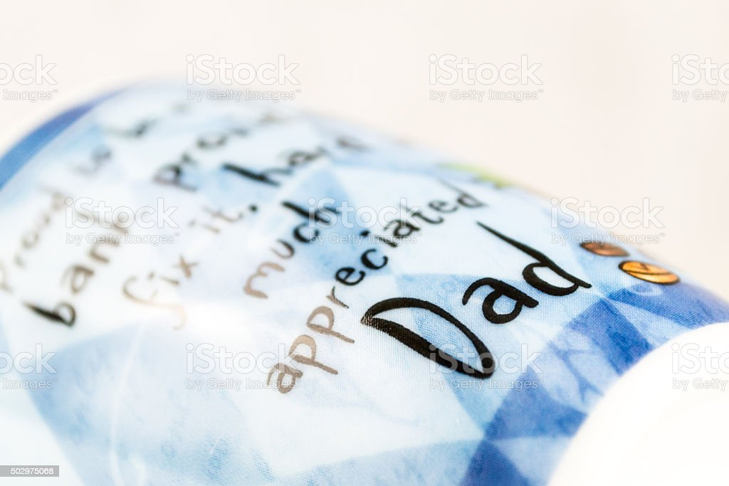 Dad Sign Highlighted in a Blue Cup stock photo