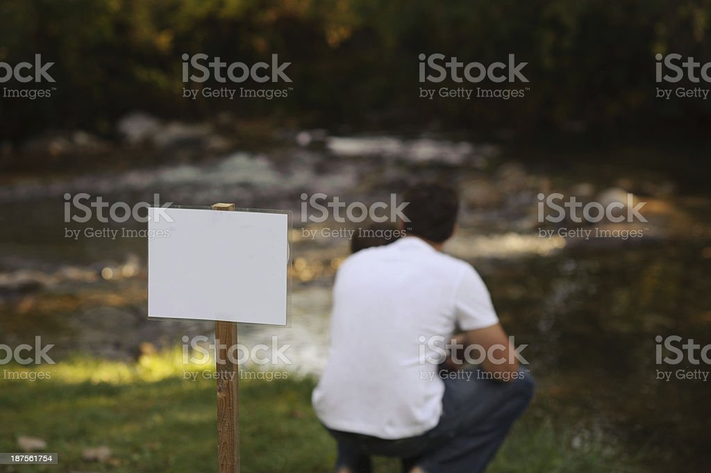 Dad Sitting outside with his son. royalty-free stock photo