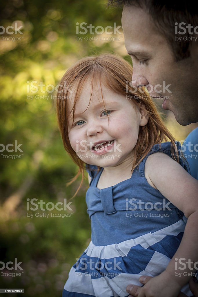 Dad Talking to His Daughter as They Play royalty-free stock photo