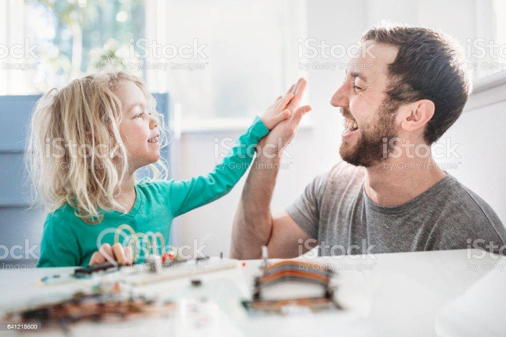 Dad Teaching Daughter Electrical Engineering stock photo