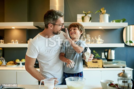 istock Dad, the flour's supposed to go in the batter 854461480
