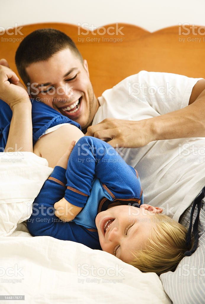 Dad tickling child. royalty-free stock photo