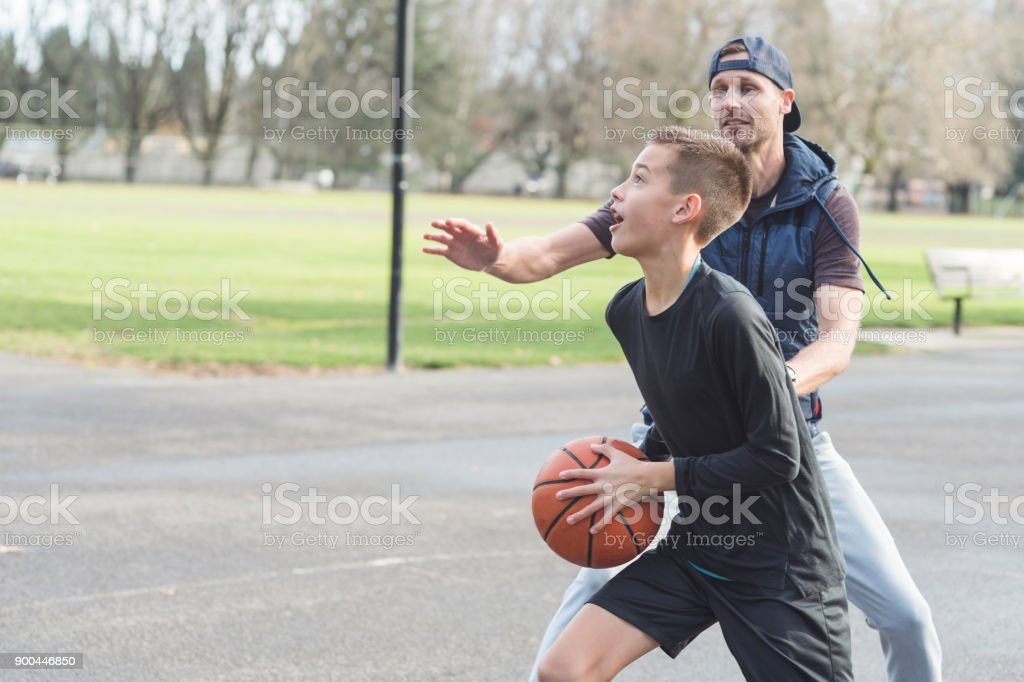 Dad Versus Son, Basketball Edition stock photo