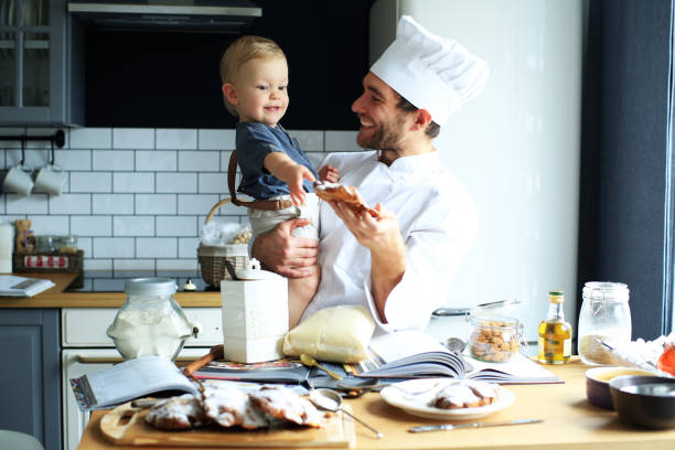 Dad with a young son to bake stock photo