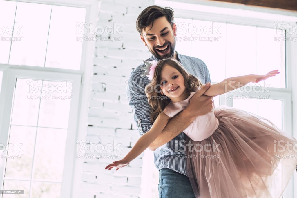 Dad with daughter at home stock photo