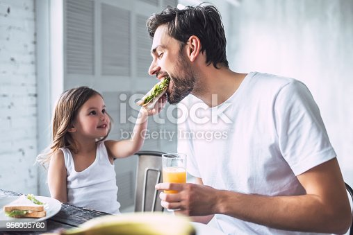 istock Dad with daughter at home 956005760