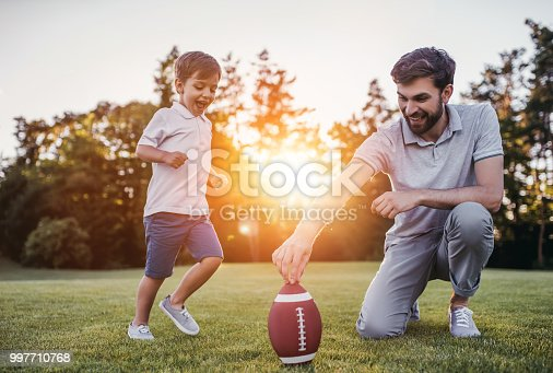 istock Dad with son playing American football 997710768