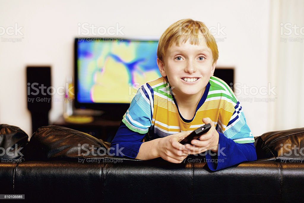 Dad, your programme is on! Eager boy by TV stock photo