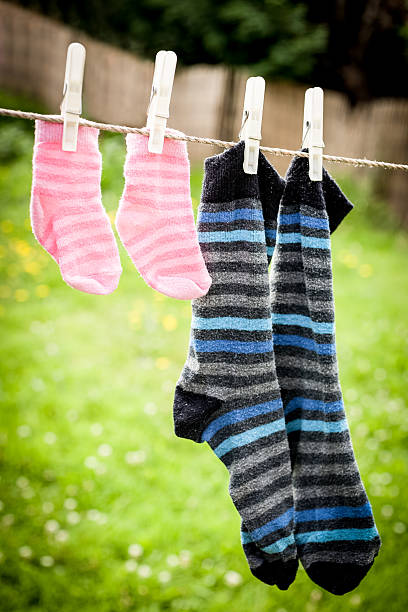 Daddy and daughter's socks stock photo