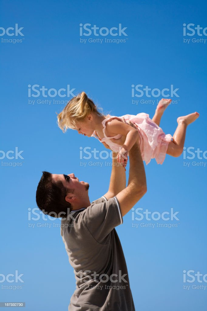 Daddy and his little girl playing toss the baby royalty-free stock photo