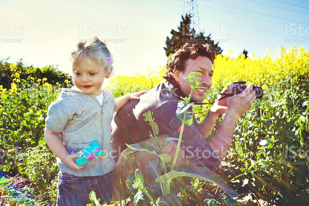 Daddy and Little Girl with Cameras in Field royalty-free stock photo