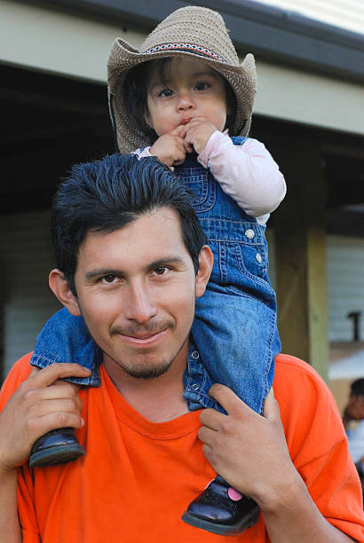 Daddy and Me Hispanic man with his daughter migrant worker stock pictures, royalty-free photos & images