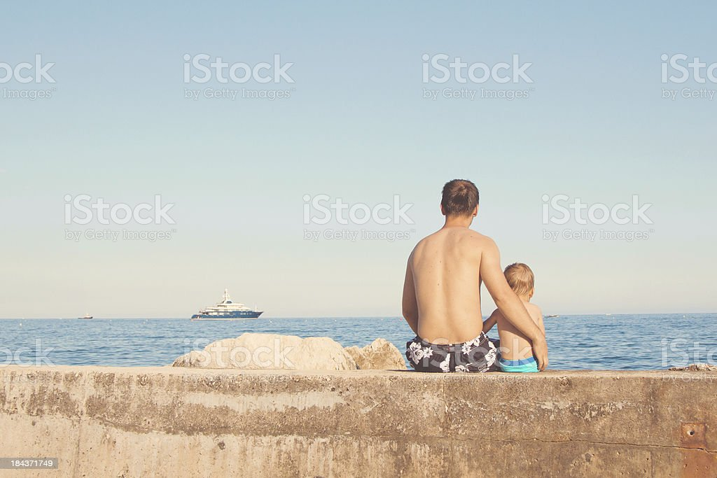 Daddy and son, watching ship royalty-free stock photo