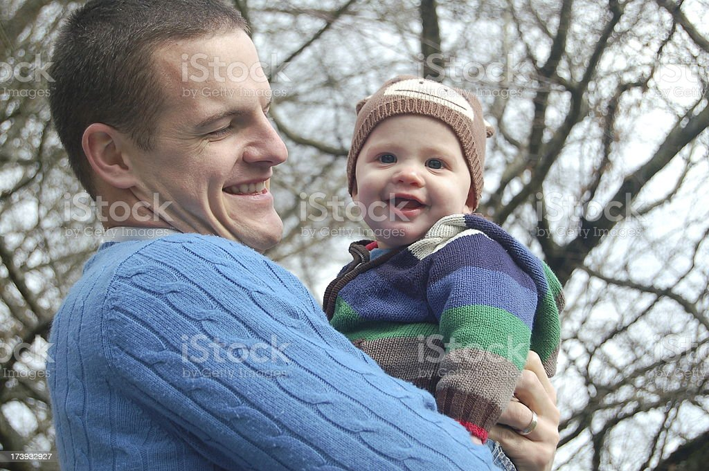 Daddy Holds Baby royalty-free stock photo