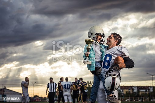 istock Daddy, I want to be a champion in American football just like you! 925646968