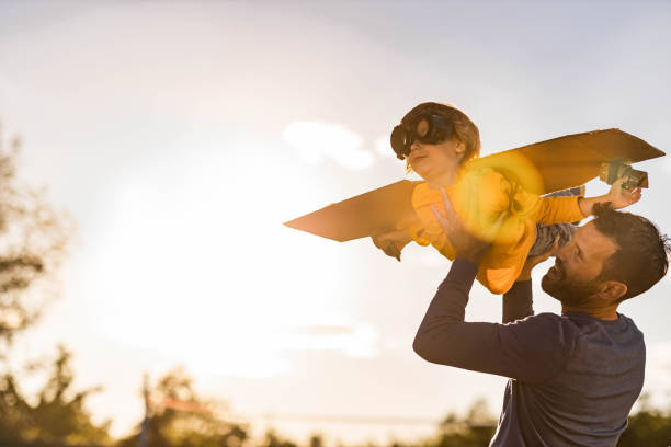 Daddy, I'm an airplane! stock photo