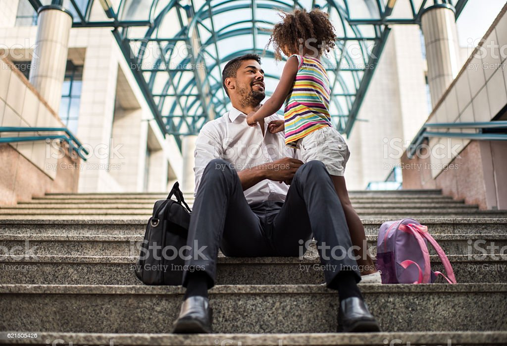 Daddy, let me button your shirt! foto stock royalty-free