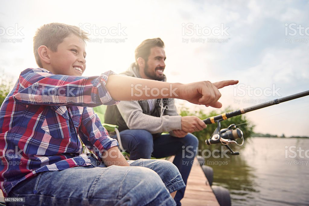 Daddy look! There is a big fish! stock photo