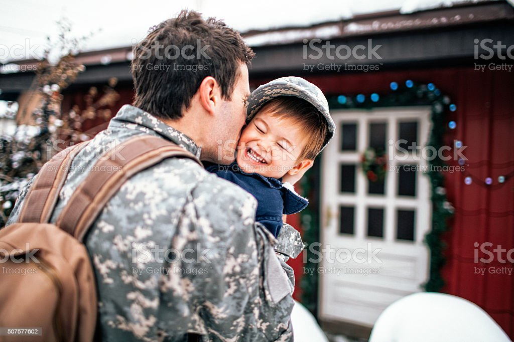 Daddy soldier is back home stock photo