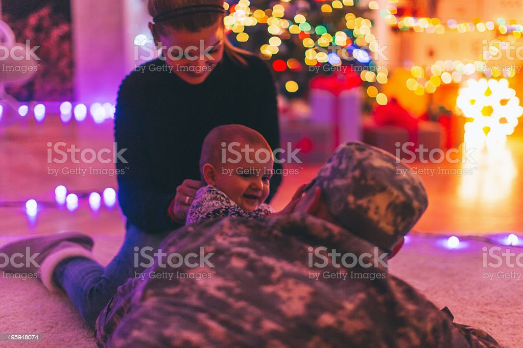 Daddy soldier's home for Christmas stock photo