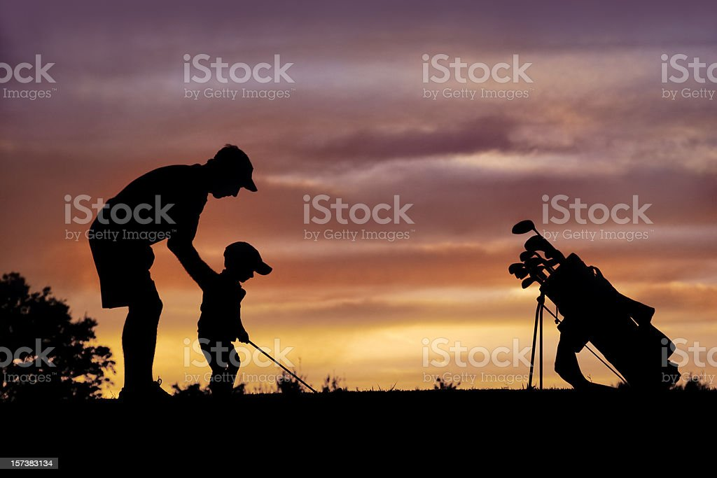 Daddy's Half Pint Golfer royalty-free stock photo