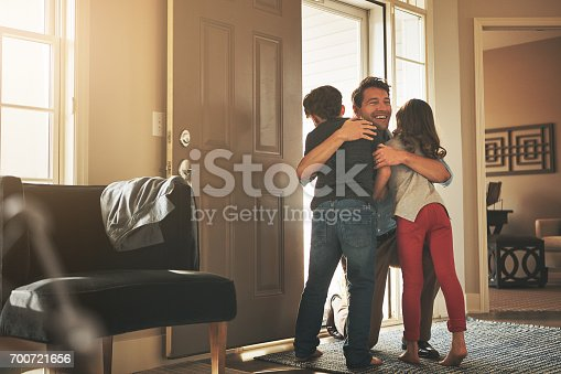 Shot of a father arriving home to a loving welcome from his son and daughter
