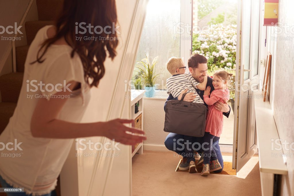 daddy's homecoming hug stock photo
